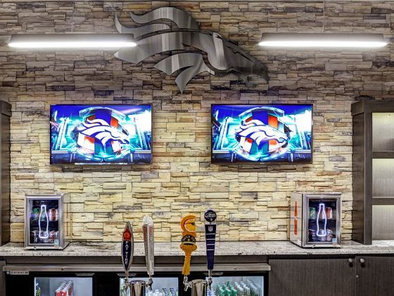 TVs on the wall in the Coca-Cola Fan Cave spotlight 560x420